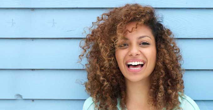 Curly haired girl smiling